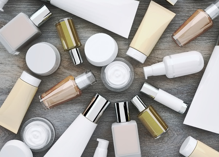 cremas faciales: Cosmetics products located on the wooden background. Top view.