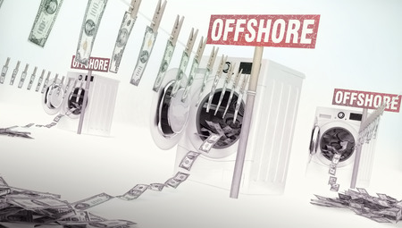 Concept of money laundering, money hanging on a rope coming out of the washing machines, money jump into the washing machines. Offshore - business idea with text. Banco de Imagens