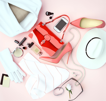 Womens fashion accessory white clothing and red high heels is located on a light  pink background. Top view. 版權商用圖片