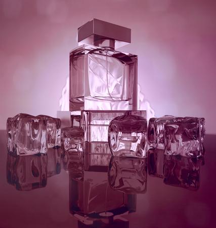 Perfume bottles on dark purple  background with reflection. Standard-Bild