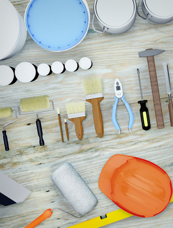 Construction tools lying on a wooden surface. Standard-Bild