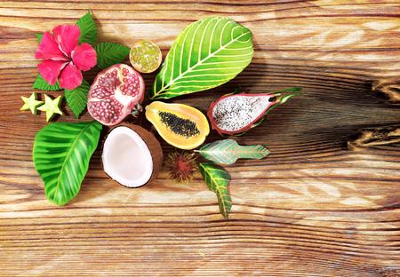 Tropical fruit on wooden background. Top view Standard-Bild