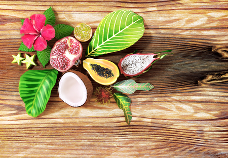 Tropical fruit on wooden background. Top view 版權商用圖片