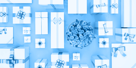 Gift boxes on blue background. Top view. Gift boxes and flower bouquet on color background. Festive background.