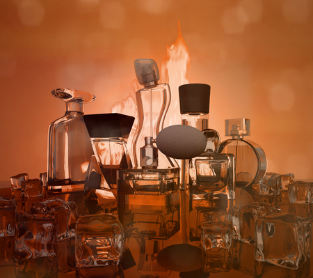Different bottles of perfume on dark red background.