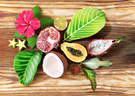 Fresh tropical fruit on wooden background, Top view.