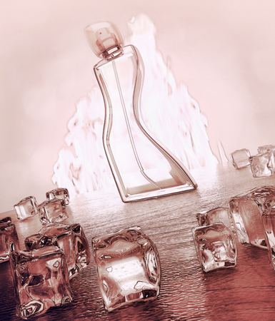 Perfume bottle on dark wooden background with reflection. Fire and ice. Standard-Bild