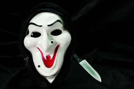 ghost mask: Halloween ghost face mask with knife Stock Photo