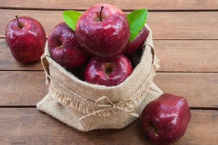 apple sack: Apple sack on wooden table Stock Photo