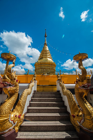 stair well: Well decorated stair to the pagoda of famous ancient temple in Chiang Mai, Thailand, Wat Phra That Doi Kham Temple of the Golden Mountain Stock Photo