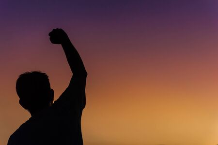 Silhouette of happy victory man