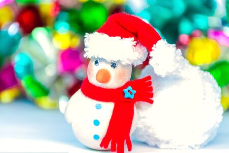multi colors: Snow man over blurred shiny yellow strip, blue star and white background for CSnow man over blurred shiny multi colors, and white background for Christmas new year decorationhristmas new year decoration Stock Photo