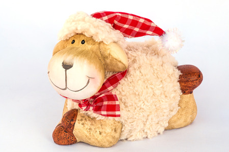 soft object: Smiling sheep sitting on white soft cloth as snow isolated over white , Christmas decoration object