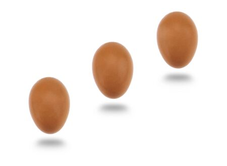 l natural: Three fresh eggs with soft shadow isolated over white