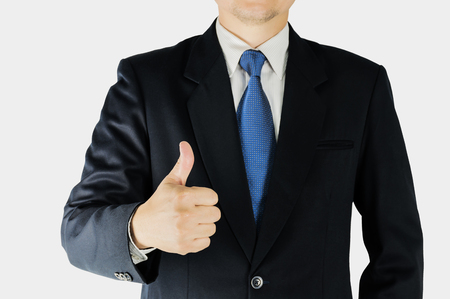 thumps up: Businessman is doing thumps up sign over white background. Photo is focused at hand. Photo includes clipping path.