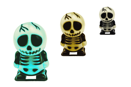 Variety size and color of skeleton toy for Halloween decoration isolated over white Stock Photo