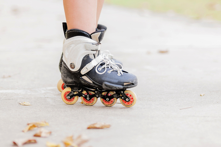 roller blade: Closeup of boy is standing with roller blade, selective focused. Stock Photo