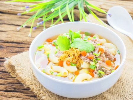 Macaroni soup putting on sack cloth and wooden background