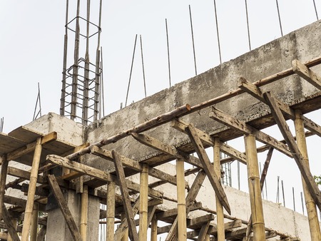 stirrup: On site construction site showing beam and column with reinforce steel bars and wooden bracing structure Stock Photo