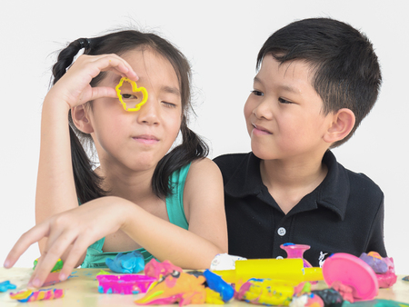 Selective focused of happy Asian kids playing colorful clay toy Stock Photo