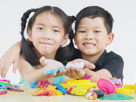 playdoh: Selective focused of Asian kid playing colorful clay toy Stock Photo