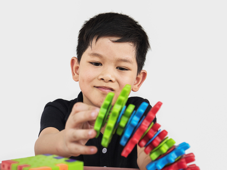 Asian children are playing puzzle plastic block creative game to practice their physical and mental skill Stockfoto