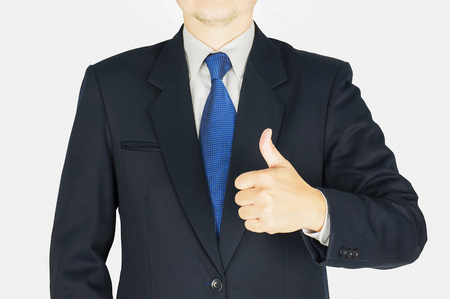 thumps up: Businessman is doing thumps up sign over white background. Photo is focused at hand Stock Photo