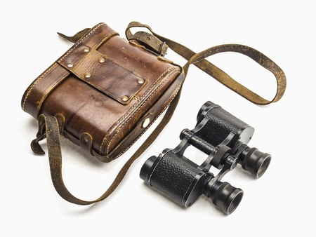 map case: Old antique binoculars and its brown leather bag cover isolated over white background Stock Photo