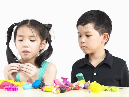 playdoh: Selective focused of happy Asian kids playing colorful clay toy Stock Photo