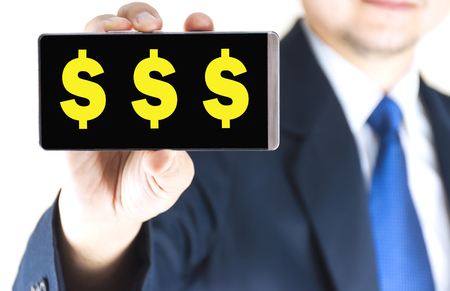 tripple: Yellow tripple dollar sign, $$$, character on mobile phone screen in blurred young businessman hand over white background, business concept