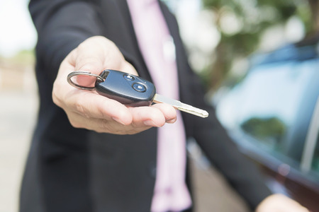 selling service: Man is giving a car key to somebody Stock Photo