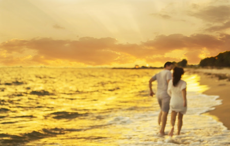 yesteryear: Blurred photo of  Asian couple running on beach
