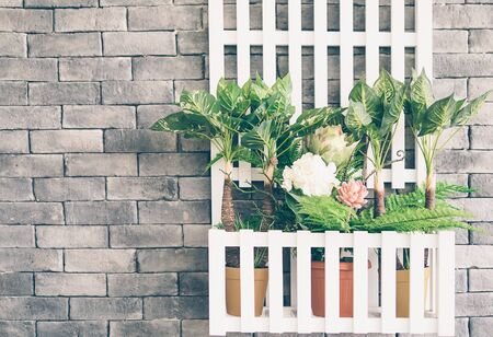 yesteryear: Vintage photo style of wooden hanging flower basket on gray wall background