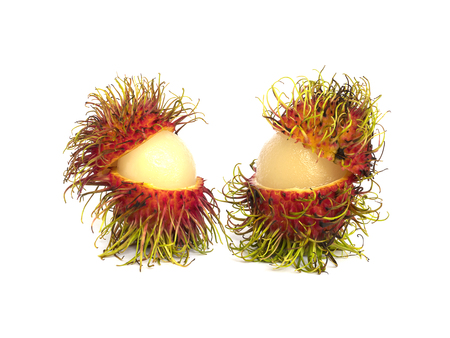 partial: Twin partial peeled rambutans isolated over white Stock Photo