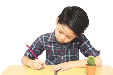 curiously: A boy is curiously doing homework