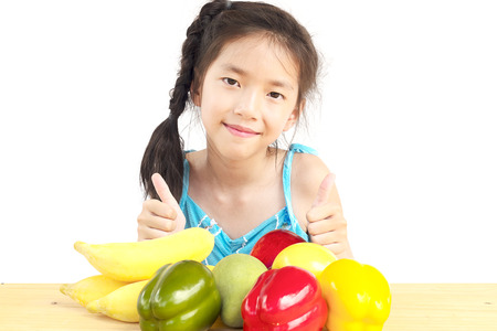 gril: Asian healthy gril showing happy expression with variety colorful fruit and vegetable over white background