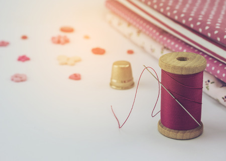 warm cloth: Warm tone photo of pink embroidery set with cloth over white background Stock Photo