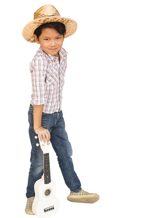 thai musical instrument: Asian boy is standing with ukulele isolated over white. Photo includes CLIPPING PATH. Stock Photo