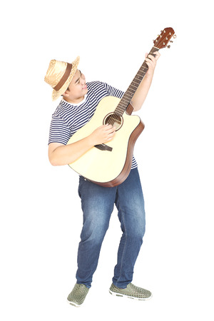 thai musical instrument: 14 years Asian boy is happily playing guitar isolated over white Stock Photo