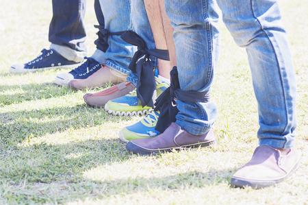 Five legged race outdoor party game, harmonious unity concept