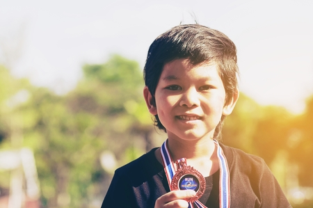 Boy getting bronze medal in his school sport day 免版税图像