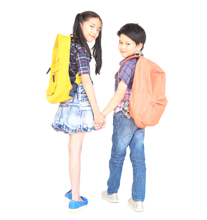 Lovely Asian couple school kids, 7 and 10 years old, isolated over white