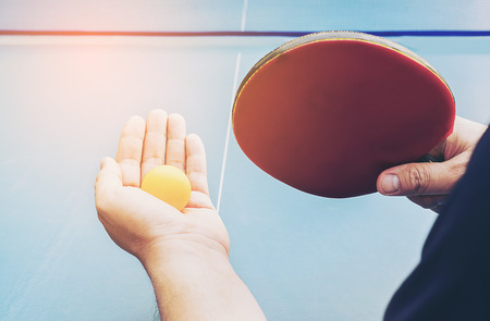 A man play table tennis ready to serve Stock Photo