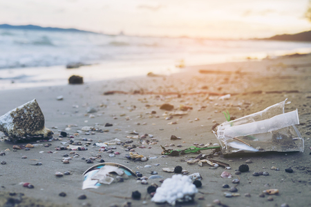 Trash on sand beach showing environmental pollution problem