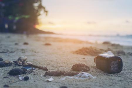 Trash on sand beach showing environmental pollution problem