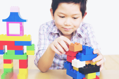 A boy playing pieces plastic creative construction blocks Stock Photo