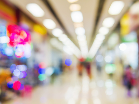 decorate: Blur superstore hall background with bokeh light Stock Photo