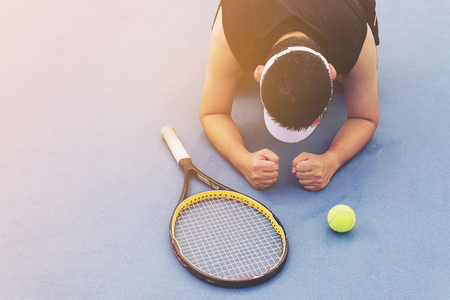 Sad tennis player sitting in the court after lose a match Stok Fotoğraf