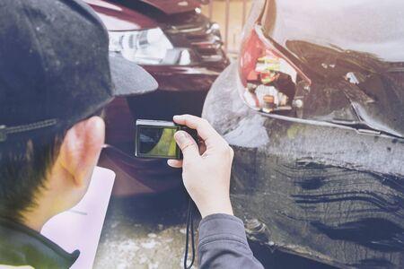 Insurance agent working on car accident claim process Reklamní fotografie