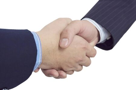 Close up of two business man shake hands firmly isolated over white. 免版税图像